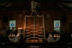 Historic church wedding alter illuminated by beeswax candles | An Effortless Real Green Wedding In The Appalachian Mountains Of Linville, NC