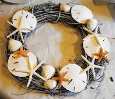 DIY - A Coastal Style Seashell Wreath http://thegraphicsfairy.com/diy-a-coastal-style-seashell-wreath/