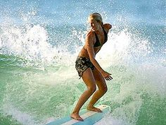 Bethany Hamilton-She lost her arm from a shark attack and still worked out and looks fabulous