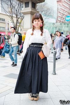 "May 2015: Yuppo is wearing a shirt from Grimoire with a maxi skirt from RoseMarie seoir by Syrup (with a waistband that reads ""Once Upon a Time""). Her bag is from Theatre Products and her silver wooden sole platform shoes are by Jeffrey Campbell. She is also wearing flower and pearl earrings from Sretsis, a necklace from Grimoire, and a couple of rings."