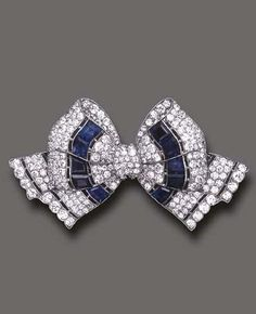 AN ART DECO SAPPHIRE AND DIAMOND BROOCH, BY TIFFANY & CO