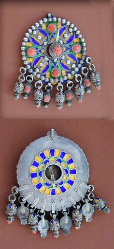 "Africa | Old silver enamelled Kabyle "" Tabzimt ""or fibula from Grande Kabylie, in Algeria. Blue, yellow and green enamel and embellished with real red coral cabochons and nine pendants enamelled and decorated with coral stones. The back side is decorated and enamelled too 
