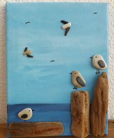 tableau galets décoratifs représentant un paysage marin original