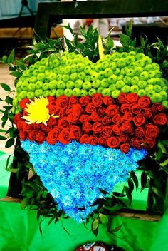 "ERITERIA! vISIT the land of "" Can"" Do people. Eritrea flag in Flowern - One heart, One People! #Eriteria"