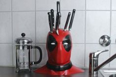 There's no question about how much we all loved Deadpool. So, why not add some Deadpool knife block to you kitchen? We guarantee this is probably the best knife block we've ever seen. Geek Decor, Geek Culture, Knife Holder, Tv Holder, Geek Gadgets, 3d Prints, Knife Block, Kitchen Gadgets, Geek Stuff