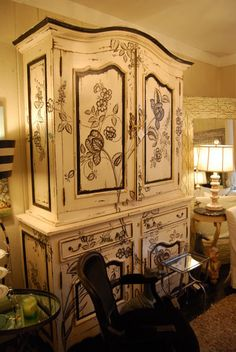a toile style paint job on this armoire