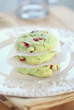 1 pouch Betty Crocker Sugar Cookie Mix 1 box (4 serving size) pistachio instant pudding and pie filling mix 1/4 cup flour 1/2 cup butter, melted 2 eggs 1 cup dry roasted salted pistachio nuts, chopped 1/2 cup dried cranberries, chopped optional - green food coloring (I didn't add any but if you wanted them extra green you could) 350 degrees for 8-10mins