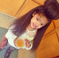 Cute bun! For more articles and pictures like this, check out our blog: www.naturalhairki... Natural hair | hair care | natural hair care | kids hair | kids hair care | kid hairstyles | inspiration