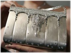 Leave it to the Japanese women to up yours with this Platinum Handbag.    $187,307,689.00    Take that Louis Vitton!