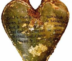 Four hundred years after they were buried in heart-shaped lead urns, five embalmed human hearts have been discovered in a cemetery in northwestern France.