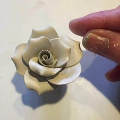 pinching edges of clay petals