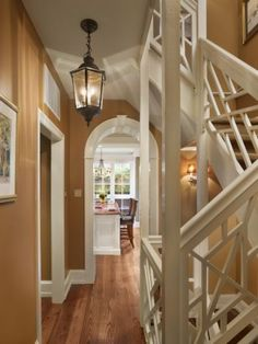 Not often seen on interior staircases, the Chippendale balustrades in this Philadelphia home complement the bold white trim throughout the house.