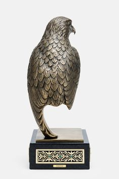 Masterfully crafted feather details on bronze bust ornamented with black onyx eayes and green agate gemstones.