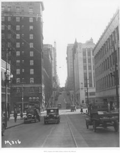 """1930:  KC population:  399,746, Foreign born:  6%, Black: 10%, Male/female ratio:  99 males to every 100 females.  Adults over 25 with college degrees: 6%, Common Professions:   meat-packing, wholesale & retail sales, construction, flour production, railroading, domestic services, dress-making, Popular Radio Shows:  Goodman and Jane Ace (KMBC), Amos N' Andy, """"Slatz"""" Randall's orchestra at the Hotel Muelbach, the Cook Painter Boys (WDAF)."""