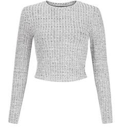 """Bring crop tops into an autumn/winter wardrobe with this ribbed crop top - ideal paired with navy ripped knee skinny jeans and block heel ankle boots.- Ribbed texture- Simple long sleeves- Rounded neckline- Cropped hem- Casual fit- Model is 5'8""""/176cm and wears UK 10/EU 38/US 6"""