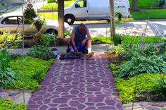 My husband used a cement mold for making pathways as a stencil and painted our front walk.
