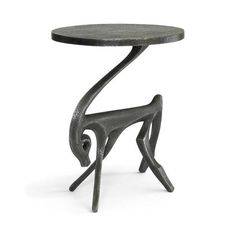 What could be more streamlined and elegant than a gazelle? Only this iron rendering, poised to hold your cocktail or cheese platter with grace. Gazelle Black Iron Side Table by DwellStudio, $1575; dwellstudio.com   - HouseBeautiful.com