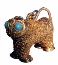 Ancient Persian Gold Locket, a stylized animal, with turquoise eyes. 900AD