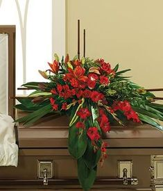 half funeral flower casket spray of red roses, red lilies, red gladiolus with greens for delivery Funeral Floral Arrangements, Church Flower Arrangements, Church Flowers, Dad Funeral Flowers, Remembrance Flowers, Remembrance Sunday, Casket Flowers, Funeral Caskets, Funeral Sprays