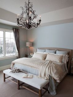 , Traditional Bedroom Remodel Ideas With Light Blue Wall Paint Color Also White Fabric Wooden Bench Also Wonderful Chandelier Design Also Beige Quilt And Pillowcase Color Also Light Brown Carpet: Bedroom Remodeling Ideas for New Atmosphere: