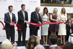 Republican presidential candidate Donald Trump, together with his family, from left, Donald Trump Jr., Eric Trump, Trump, Melania Trump, Tiffany Trump and Ivanka Trump, cut the ribbon during the grand opening of Trump International Hotel in Washington. (Manuel Balce Ceneta/AP)