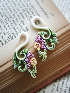 Organic Carved Bone floral ear hanger Taper Made by PluggingAlong, $36.00. I need these for my gauges!!!
