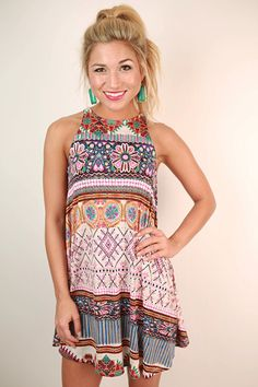 Adventure can start with your wardrobe! This colorful print dress is breezy and stretchy, and great for hot weather!