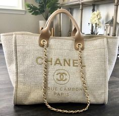 2018 Chanel deauville tote in beige. Everything in my photos will be included. - 2018 Chanel deauville tote in beige. Everything in my photos will be included. Burberry Handbags, Chanel Handbags, Louis Vuitton Handbags, Purses And Handbags, Leather Handbags, Chanel Tote Bag, Designer Handbags, Luxury Bags, Luxury Handbags