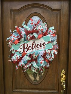 This whimsical deco mesh Christmas wreath will let family and friends know that you Believe!! The aqua and red color scheme is right on trend. It will brighten your front door, increase your curb appeal and make you the envy of the neighborhood! Features: - Aqua metallic deco mesh with red metallic and white snowball mesh ruffles - Four different wired ribbons, 2 1/2 and 1 1/2 wide - MDF sign with embossed metal word Believe - Measures 26 in diameter and 8 deep - Ready to hang ...