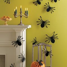 Halloween Spider Silhouettes - need to put these on the front door next year.