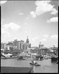 That large white boat is a banana boat!  Can't tell if it belonged to Great-grandpop or United Fruit Company - the names on the piers are either blocked or blurred. Baltimore Harbor from Federal Hill, 1948