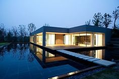 Love the openness of the house and the water as a symbol of peace.