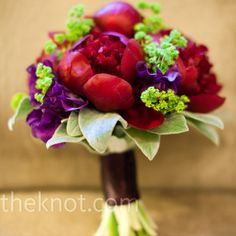 Purple and red.  Cute with the green accents.  Either take out the big leaves at the bottom or put darker green leaves.  Purple or Red ribbon.