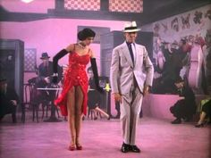 "Fred Astaire plays a cool private eye and Cyd Charisse is a slinky dame in red. From the musical film ""The Band Wagon (1953)""."
