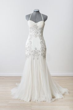 "Rent or buy this Jenny Packham ""Eloise"" wedding gown (size 4).  Have it shipped directly to your home for try-on.  If it's the one, borrow or buy for your big day."