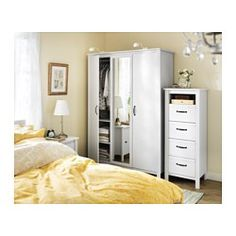 Ikea schrank brusali  A small bedroom furnished with a wardrobe with two white doors and ...