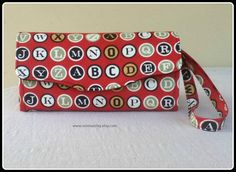 Handmade wallet made using my pattern from Emmalinebags.com:   Alphabet Cotton Fabric Clutch Wallet with Wrist Strap