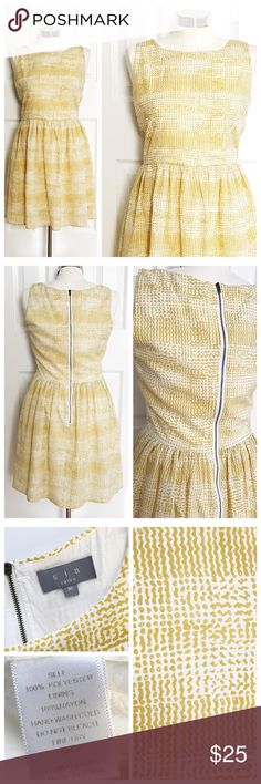 🎉HP🎉 SIA White & Marigold Sleeveless Dress Beautiful dress to wear year round! Add a blazer or cardigan and tights or heels for the warmer weather! Sleeveless scoop neck. White and gold / mustard color design. Worn a couple times - lots of compliments! Dress is lined. Exposed zipper up back in a dark gold / bronze finish. Size medium.  🎉host pick🎉fresh fashion finds party🎉5.19.2017🎉 SIA Dresses