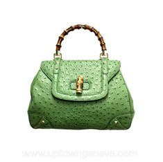0c518ecc4702a Divine green bag! Twist latch and handle in bamboo. Concertina sides, inner  has. Downtown Uptown Genève
