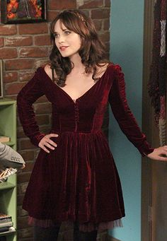 Zooey Deschanel's Burgundy velvet dress for Thanksgiving on New Girl.  Outfit…