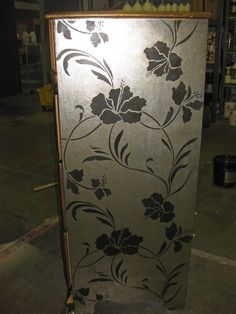 This old dresser has been given a new life with some metallic foil and Wallovers Mikala's Tropic stencil!