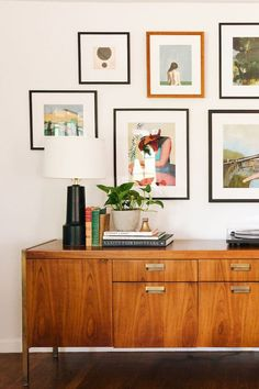 Cool and colorful gallery wall over a vintage console cabinet