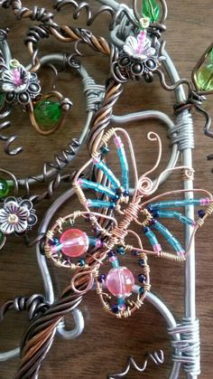 Wire wrapped beaded sun catcher, butterfly.