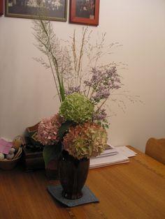 Here is a dried floral arrangement from my gardens.  Hydrangea flowers dry perfectly if you put them in a vase full of warm water and never refill it.