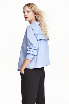 Wide blouse with a frill