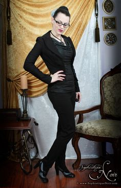 Professional wear; all-black outfit; black blazer, black pencil skirt, black tights; jewelry