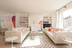 Pastel confection - desire to inspire - white living room with chevon rug and a pair of white sofas
