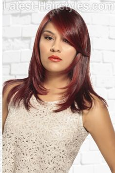 Vibrant Red Haircolor with Block Coloring | For appointments at Stewart & Company Salon, call (404) 266-9696.