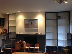 Billy bookcases turned custom. love the dark trim for extra style. Add doors for closed storage? love the desk on the left