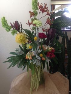 Tall arrangement of Bells of Ireland, Kangaroo Paw, Protea, Mixed Succulents, Alstromaria and Carnations.  Perfect for use at the ceremony and then later at the reception.